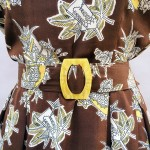 This dress is brown and gold. #1940s novelty print rayon…